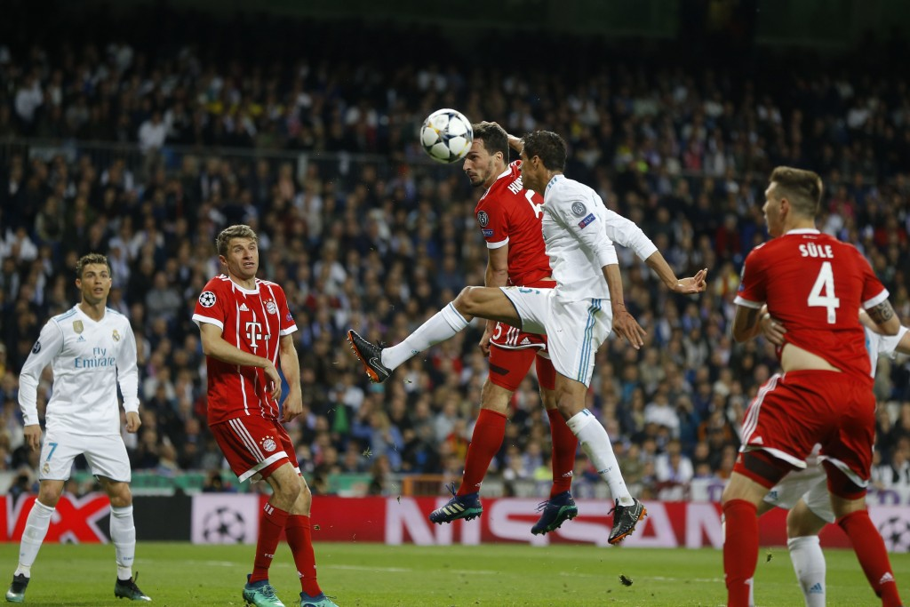 Bayern's Mats Hummels and Real Madrid's Raphael Varane challenge for the ball during the Champions League semifinal second leg soccer match between Re...