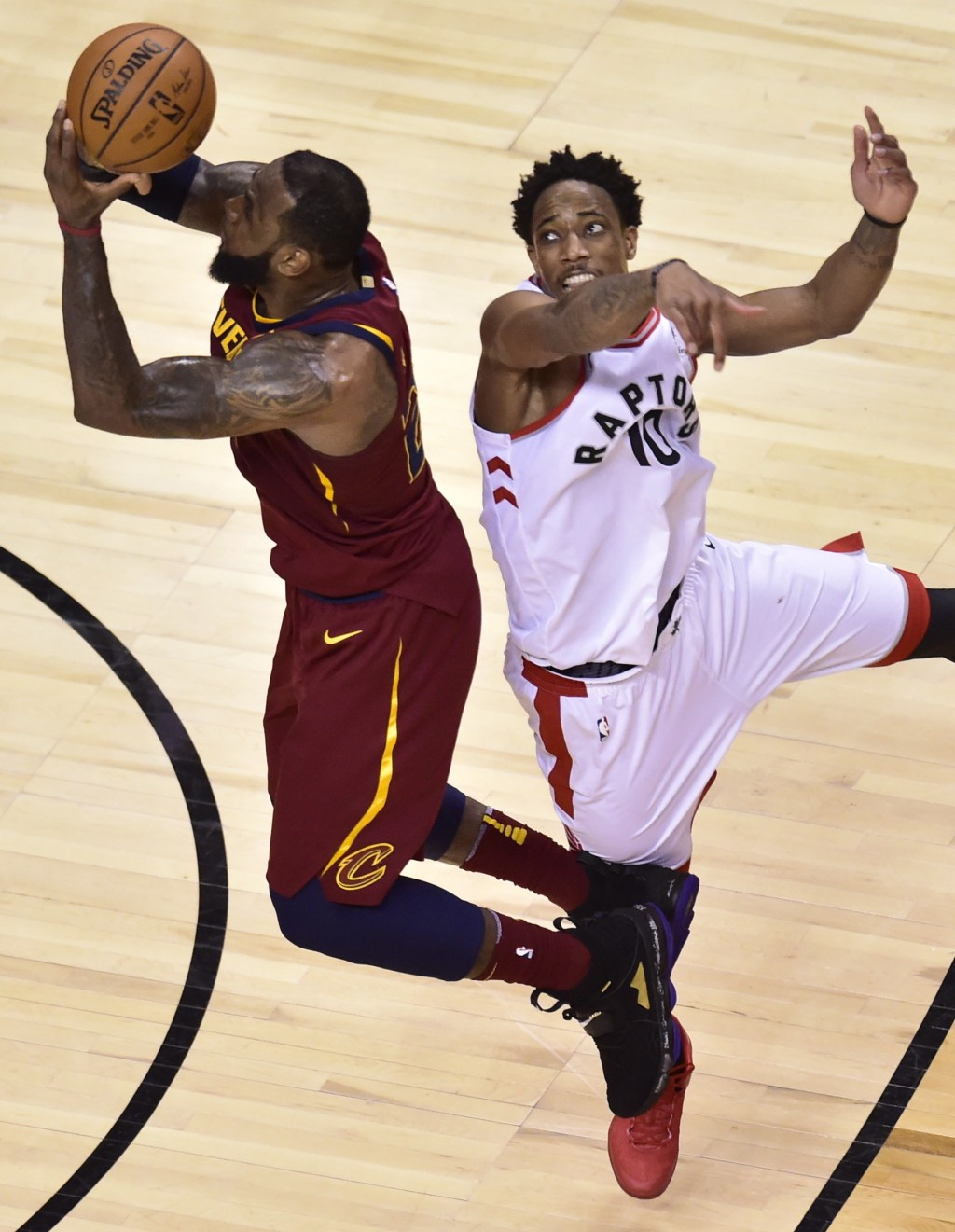 Cleveland Cavaliers forward LeBron James (23) shoots after the shot clock had expired, as Toronto Raptors guard DeMar DeRozan (10) defends during over...