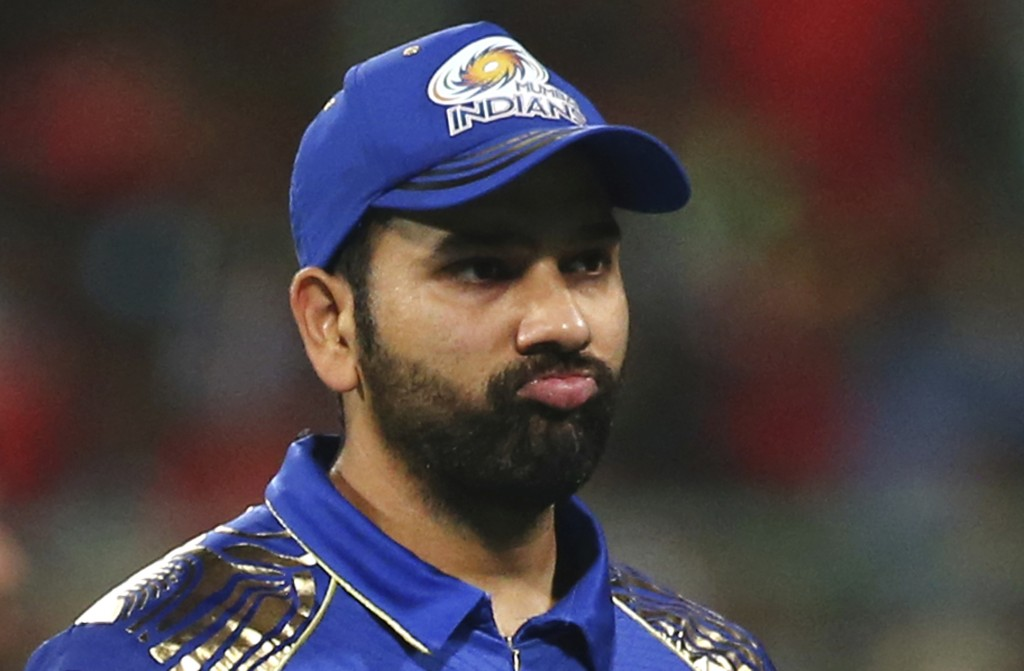 Mumbai Indians' captain Rohit Sharma gestures as he leaves the ground at the end of first innings during the VIVO IPL Twenty20 cricket match against R...