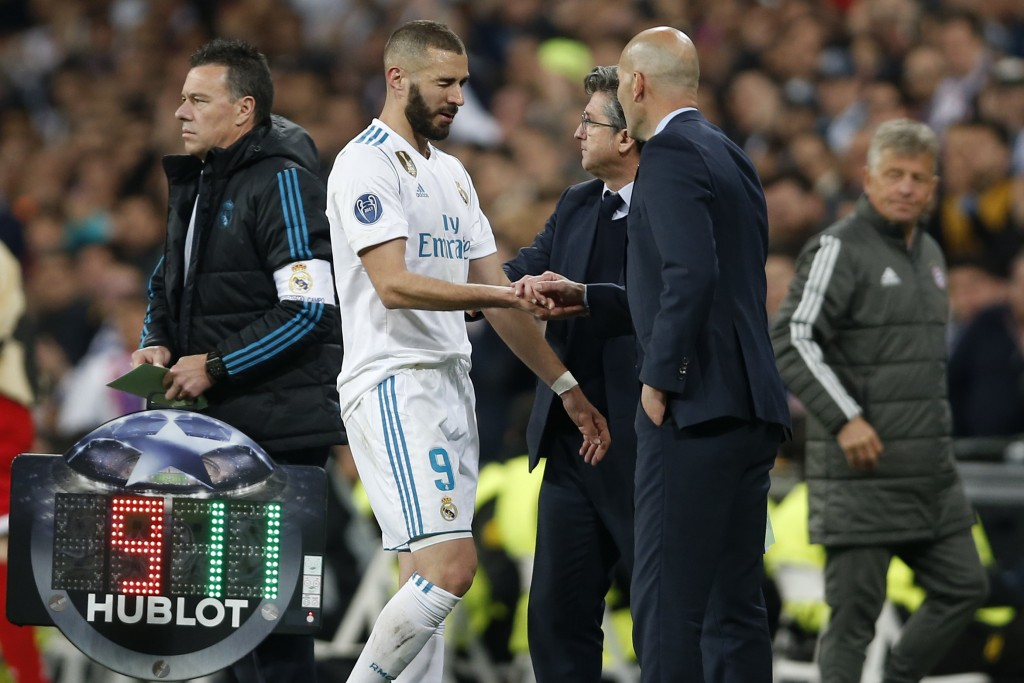 Real Madrid's Karim Benzema leaves the pitch besides coach Zinedine Zidane during the Champions League semifinal second leg soccer match between Real ...