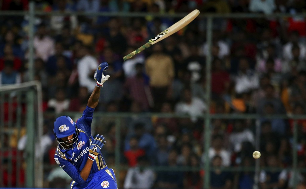 The bat slips off from the hands of Mumbai Indians' Hardik Pandya while playing a shot during the VIVO IPL Twenty20 cricket match against Royal Challe...