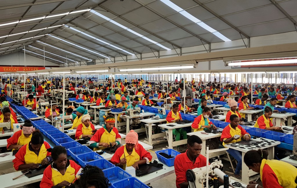 FILE - In this Thursday, Jan. 5, 2017, file photo, Ethiopian factory workers produce shoes at the Chinese company Huajian's plant in the Lebu Industri...