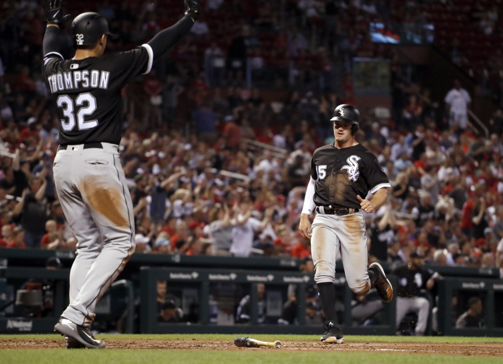 Chicago White Sox's Trayce Thompson (32) celebrates as teammate Adam Engel comes in to score on a two-run double by Yoan Moncada during the fourth inn...