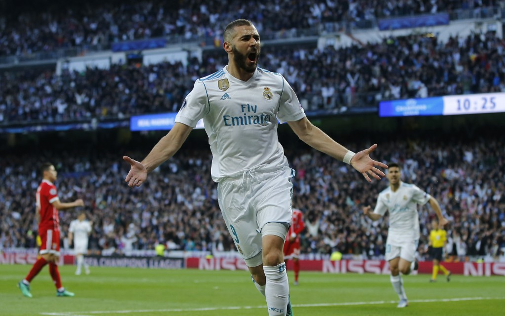 Real Madrid's Karim Benzema celebrates after scoring his side's opening goal during the Champions League semifinal second leg soccer match between Rea...