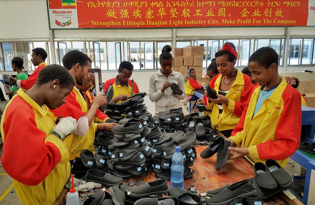 FILE - In this Thursday, Jan. 5, 2017, file photo, Ethiopian factory workers sort through shoes at the Chinese company Huajian's plant in the Lebu Ind...