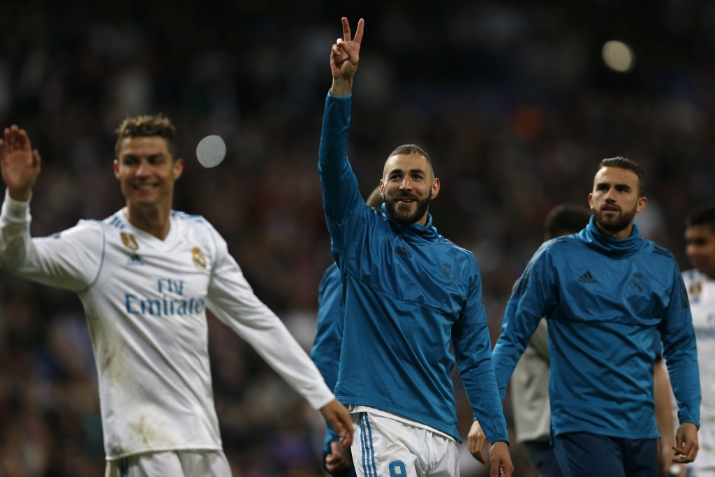 Real Madrid's Karim Benzema, center, celebrates besides team mate Cristiano Ronaldo, left, after during the Champions League semifinal second leg socc...