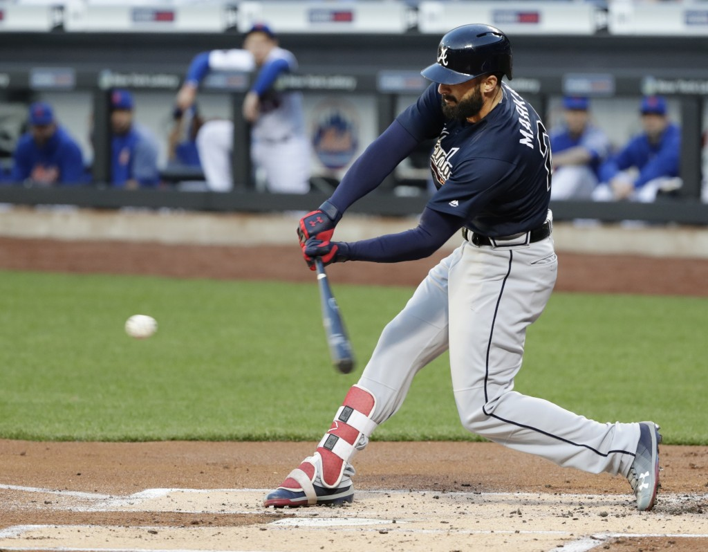 Atlanta Braves' Nick Markakis (22) hits an RBI single during the first inning of a baseball game against the New York Mets Tuesday, May 1, 2018, in Ne...