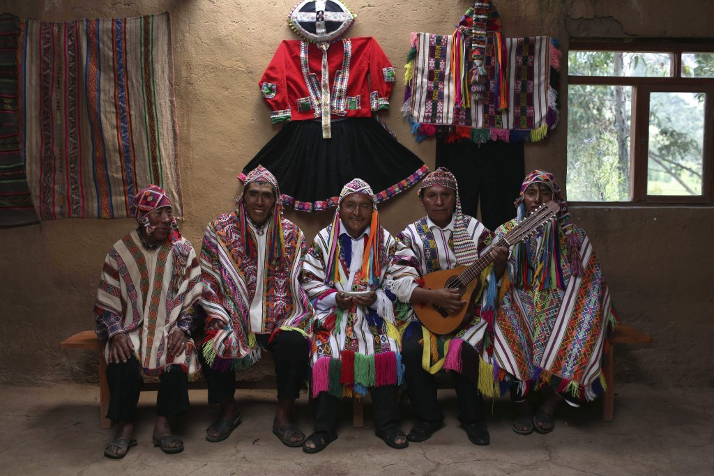In this April 4, 2018 photo, a group of musicians pose for a portrait in Pitumarca, Peru, near Rainbow Mountain where tourists are stunned by the magi...