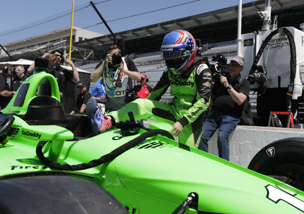 IndyCar driver Danica Patrick climbs into her car to test drive at Indianapolis Motor Speedway in Indianapolis, Tuesday, May 1, 2018. (AP Photo/Michae...