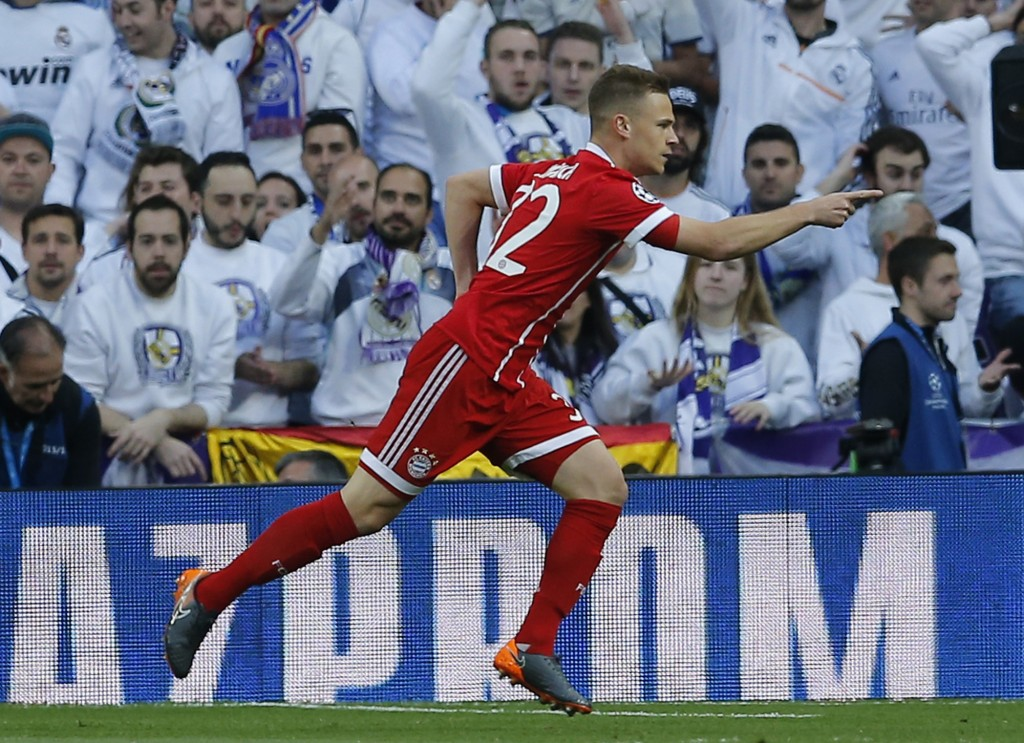 Bayern's Joshua Kimmich celebrates after scoring the opening goal during the Champions League semifinal second leg soccer match between Real Madrid an...