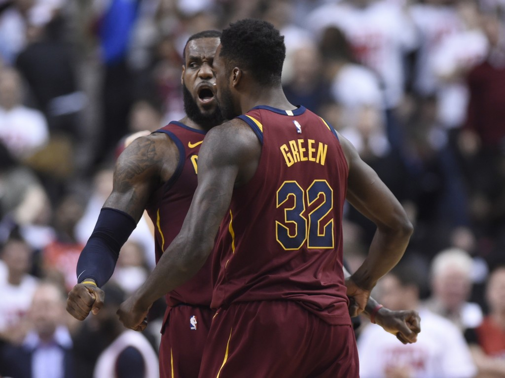 Cleveland Cavaliers forward LeBron James (23) and teammate Jeff Green (32) celebrate after the Cavaliers defeated the Toronto Raptors during Game 1 of...