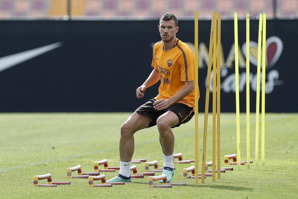 """AS Roma's Edin Dzeko wears a shirt with writing reading """"Go Sean"""", dedicated to Liverpool fan Sean Cox, who remains in a medically-induced coma follow..."""