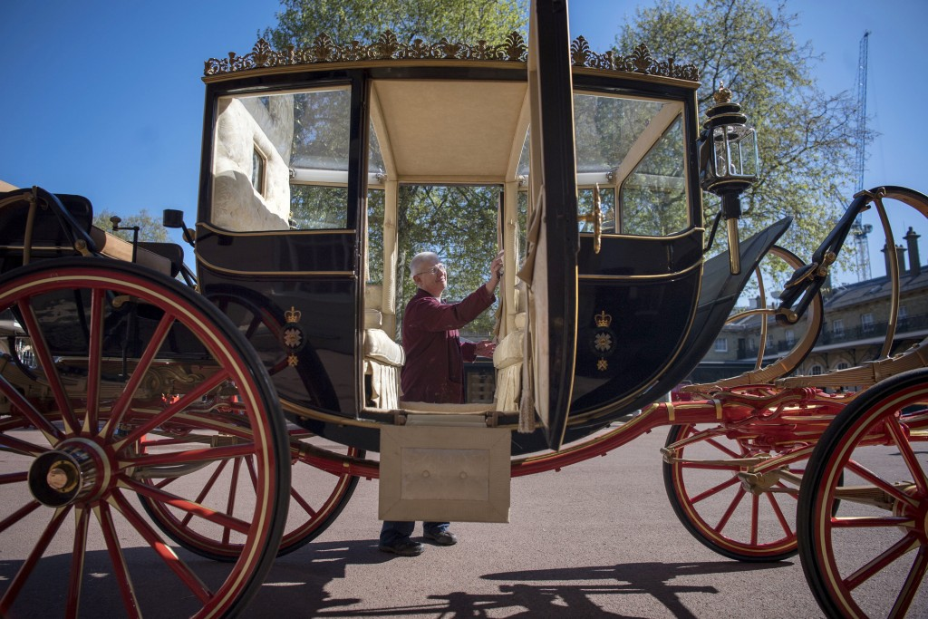 Martin Oates, Senior Carriage Restorer, polishes the Scottish State Coach, which will be used in the case of wet weather, for the wedding of Britain's...