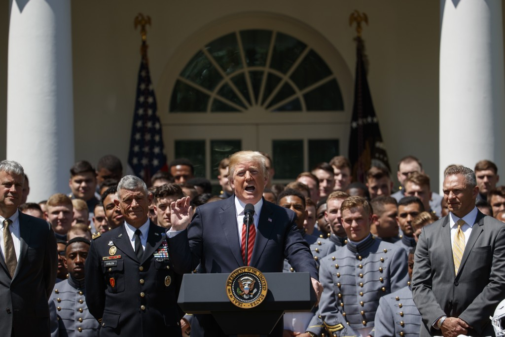 President Donald Trump speaks during a ceremony to present the Commander in Chief trophy to the U.S. Military Academy football team in the Rose Garden...