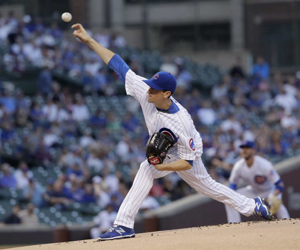 Chicago Cubs starting pitcher Kyle Hendricks delivers during the first inning of the team's baseball game against the Colorado Rockies on Tuesday, May...