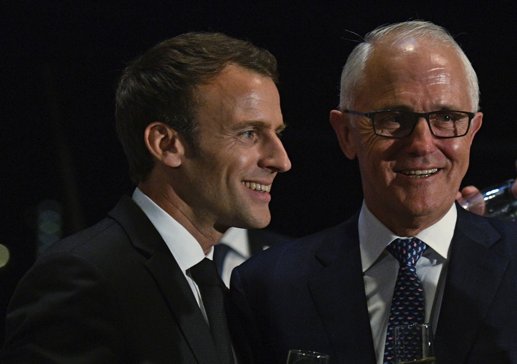 President of France, Emmanuel Macron, left, puts his arm around Australian Prime Minister, Malcolm Turnbull, during a dinner at the Sydney Opera House...