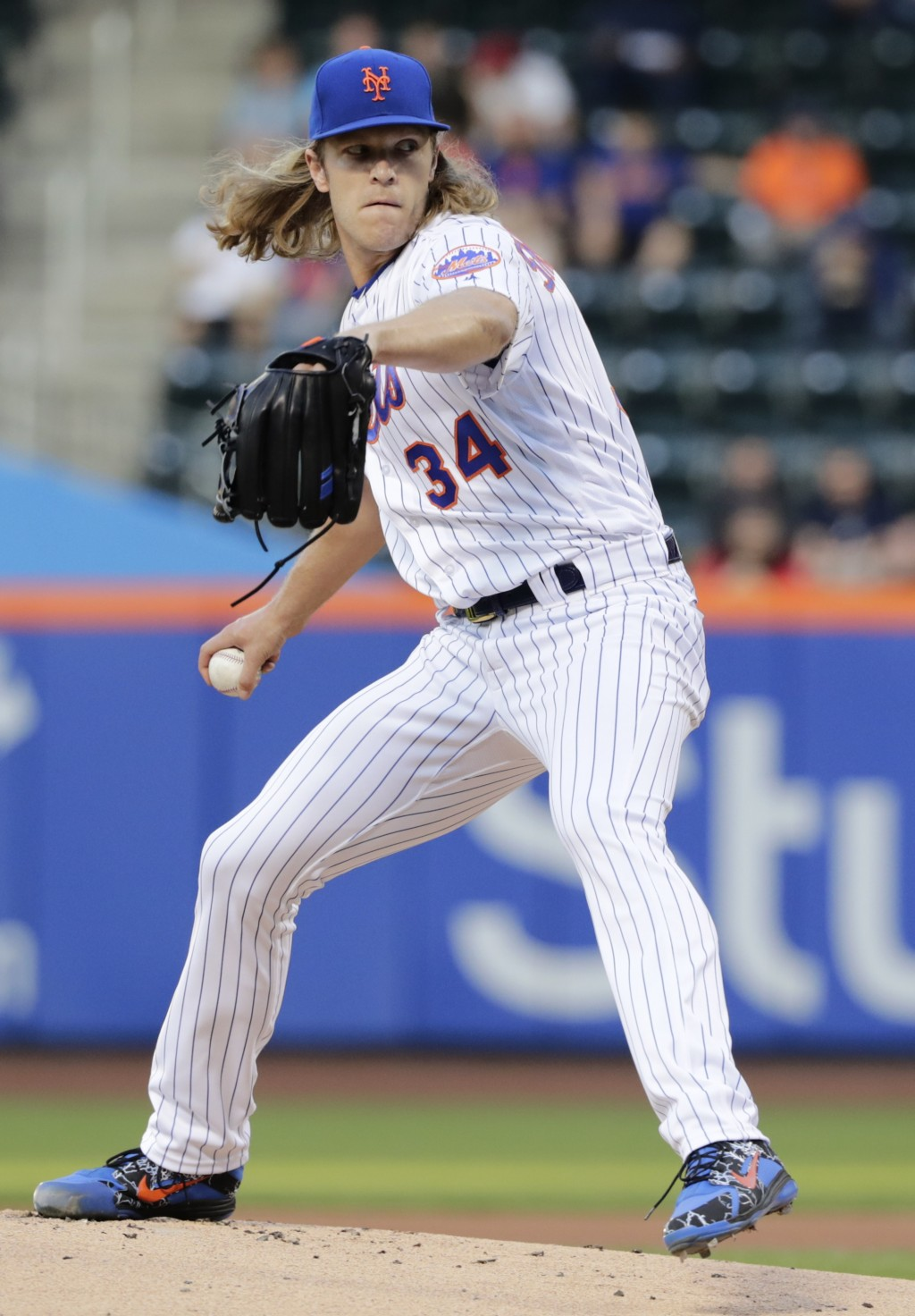 New York Mets' Noah Syndergaard (34) delivers a pitch during the first inning of a baseball game against the Atlanta Braves Tuesday, May 1, 2018, in N...