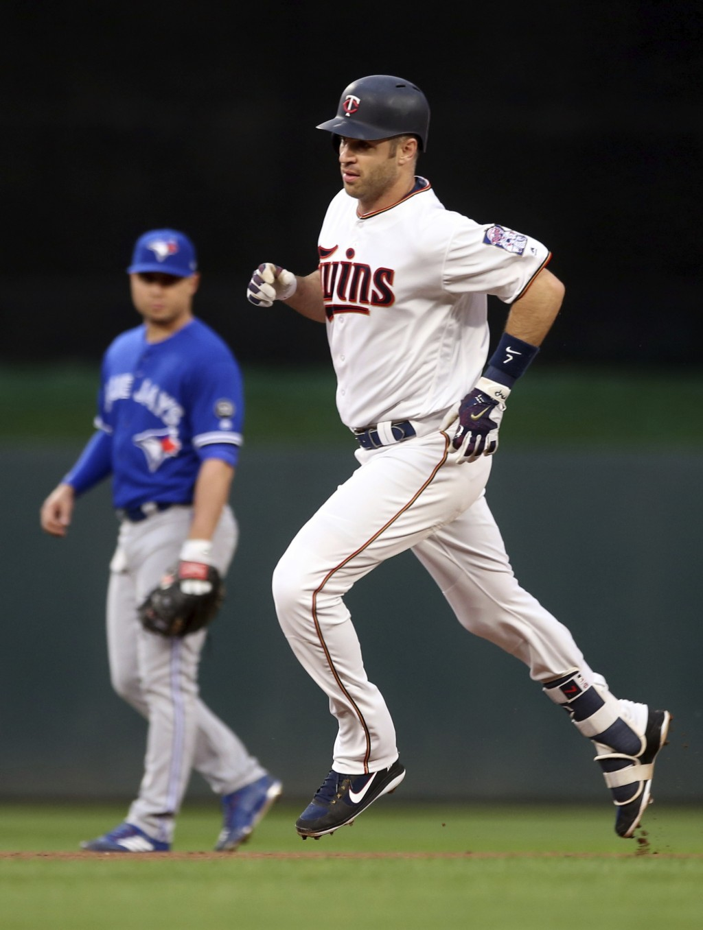 Minnesota Twins' Joe Mauer rounds the bases on a solo home run off Toronto Blue Jays' pitcher Marco Estrada during the first inning of a baseball game...