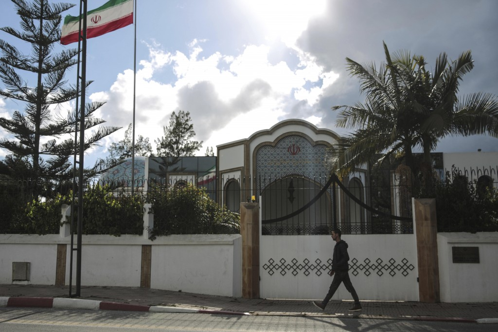 A man walks past the embassy of Iran in Rabat, Morocco, Tuesday, May 1, 2018. Morocco will sever diplomatic ties with Iran over Tehran's support for t...