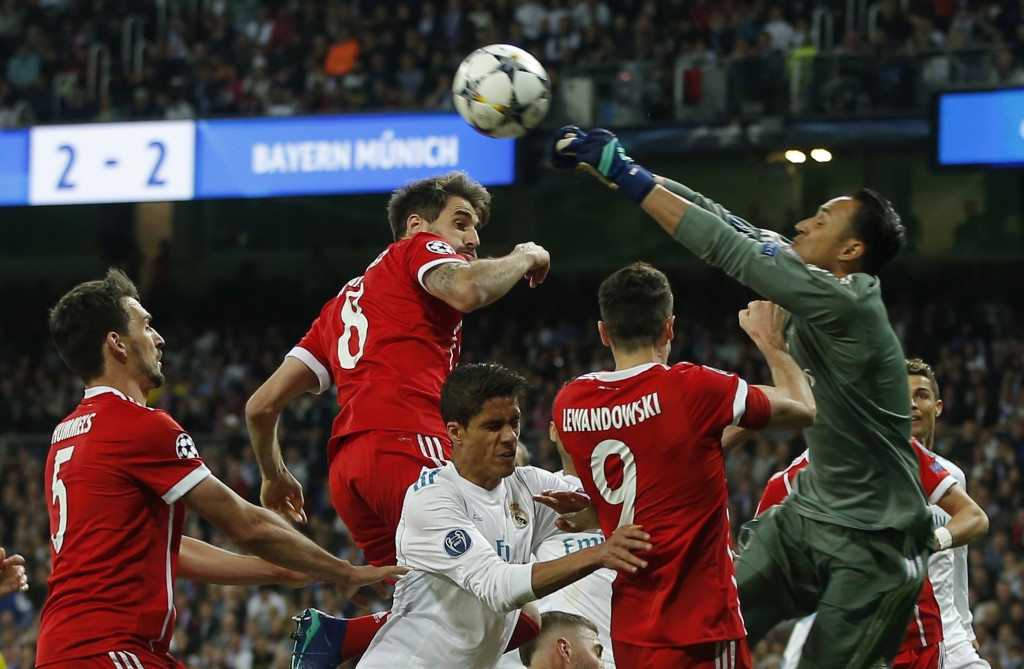 Real Madrid's goalkeeper Keylor Navas, right, deflects a ball during the Champions League semifinal second leg soccer match between Real Madrid and FC...