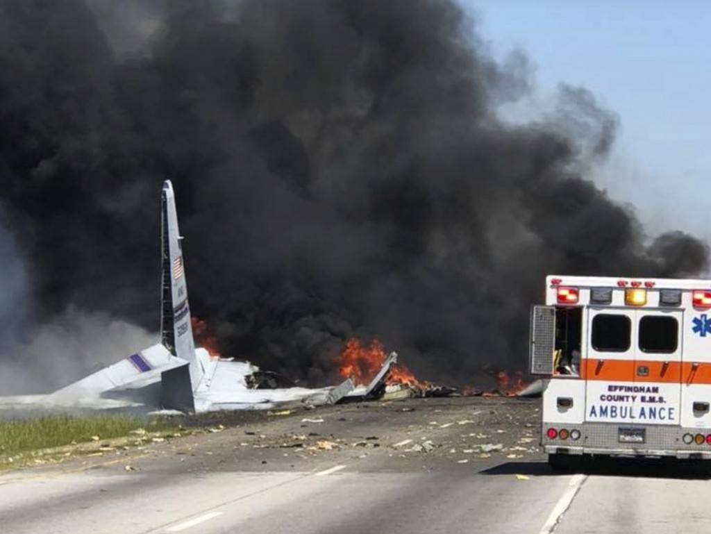 Flames and smoke rise from an Air National Guard C-130 cargo plane after it crashed near Savannah, Ga., Wednesday, May 2, 2018. (James Lavine via AP)