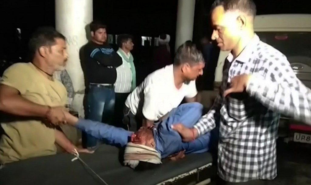This frame grab from video provided by XYZ News shows an injured being carried for treatment in the western Indian state of Rajasthan, Wednesday, May ...