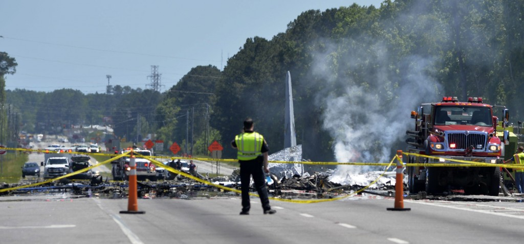 First responders work the scene of a deadly crash of an Air National Guard C-130 cargo plane from Puerto Rico near the intersection of state highway G...
