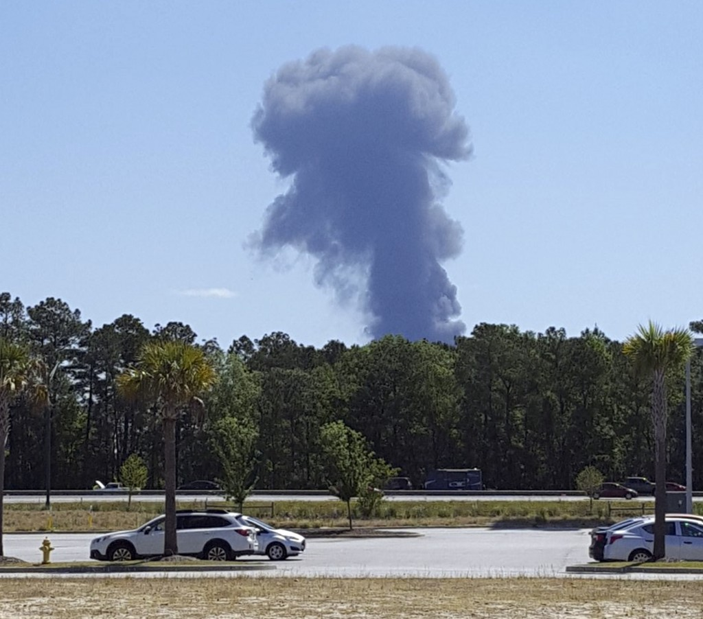 Smoke rises in the distant where an Air National Guard C-130 cargo plane crashed near an in Savannah, Ga., Wednesday, May 2, 2018, in this view from P...
