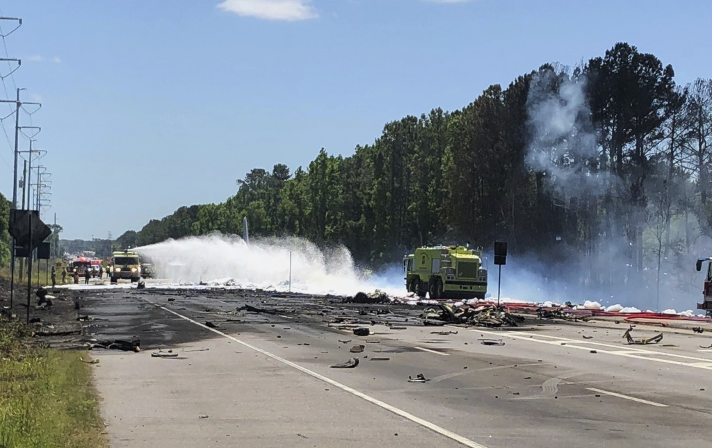Emergency personnel work at the scene of an Air National Guard C-130 cargo plane that crashed near Savannah, Ga., Wednesday, May 2, 2018. (Chris Hanks...