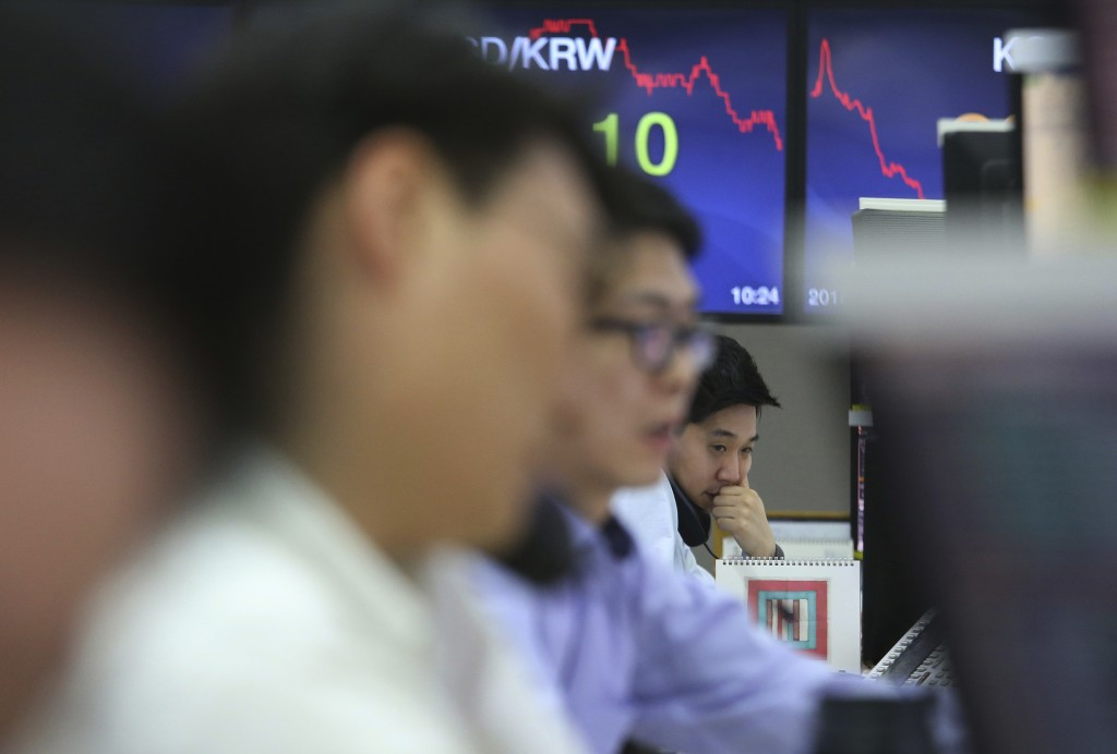 A currency trader talks on the phone at the foreign exchange dealing room of the KEB Hana Bank headquarters in Seoul, South Korea, Friday, May 4, 2018...