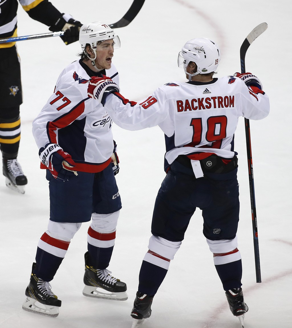 Washington Capitals' T.J. Oshie (77) celebrates his goal with Nicklas Backstrom (19) during the second period in Game 4 of an NHL second-round hockey