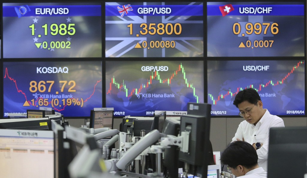 Currency traders work at the foreign exchange dealing room of the KEB Hana Bank headquarters in Seoul, South Korea, Friday, May 4, 2018. Asian stock m...