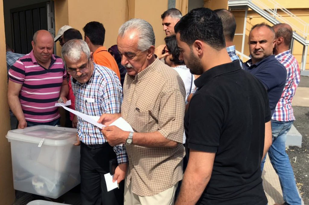 Heads of polling stations and clerks receive ballot boxes for parliamentarian elections in Beirut, Lebanon, Saturday, May 5, 2018. Thousands of ballot...