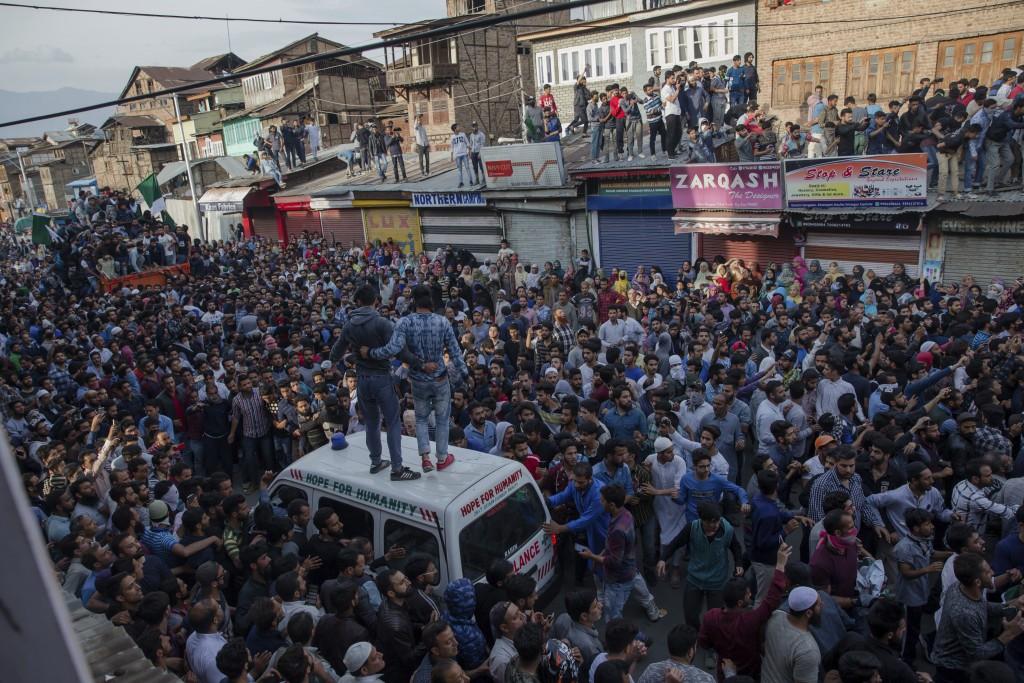 Kashmiri Muslims take part in the funeral procession of a local rebel Fayaz Ahmad Hamal, in Srinagar, Indian controlled Kashmir, Saturday, May 5, 2018...