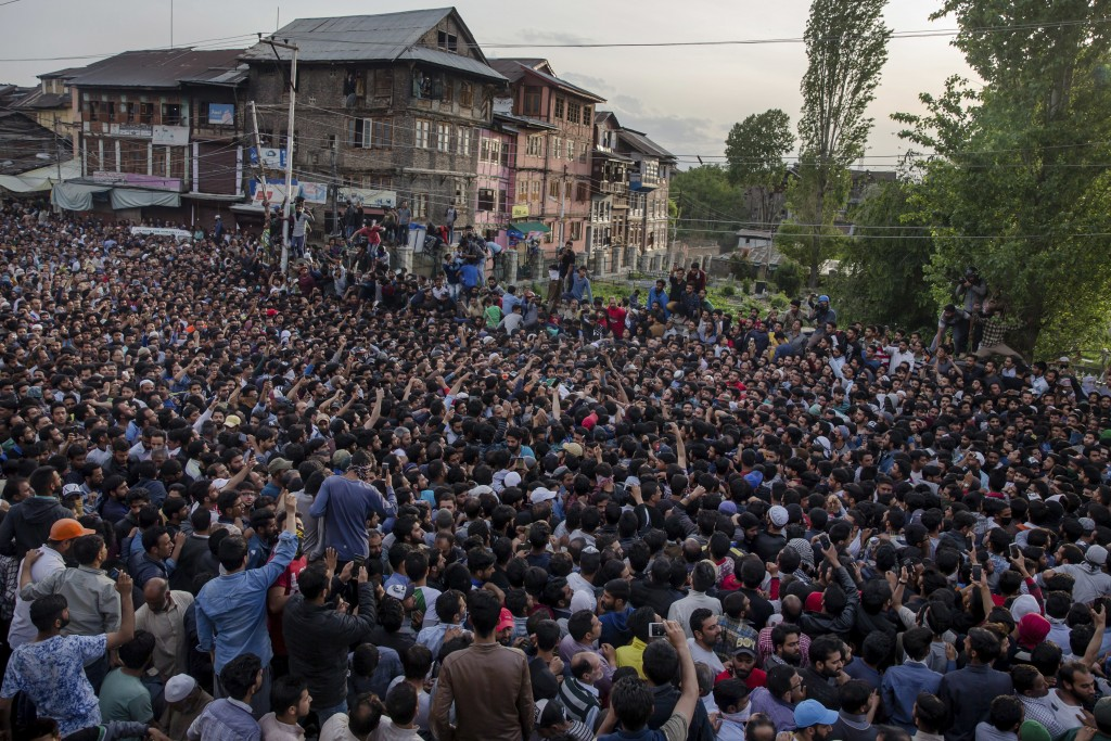 Kashmiri Muslims carry the body of Fayaz Ahmad Hamal, a local rebel, during his funeral procession in Srinagar, Indian controlled Kashmir, Saturday, M...