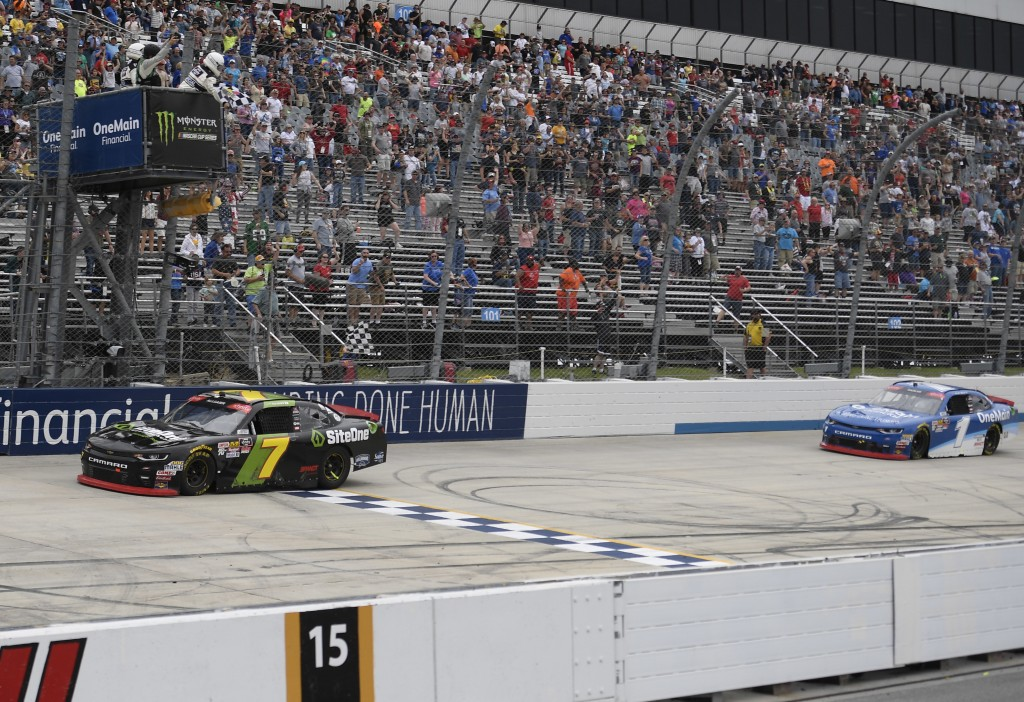 Justin Allgaier (7) takes the checkered flag in front of Elliott Sadler (1) to win the NASCAR Xfinity series auto race, Saturday, May 5, 2018, at Dove...