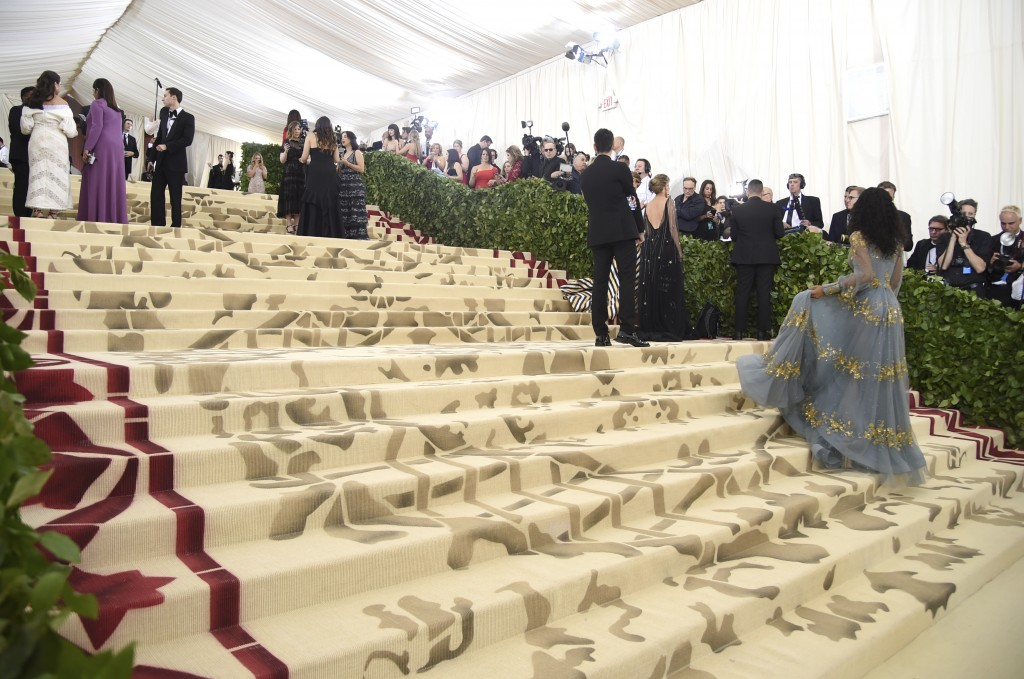 Media appear on the carpet before The Metropolitan Museum of Art's Costume Institute benefit gala celebrating the opening of the Heavenly Bodies: Fash...