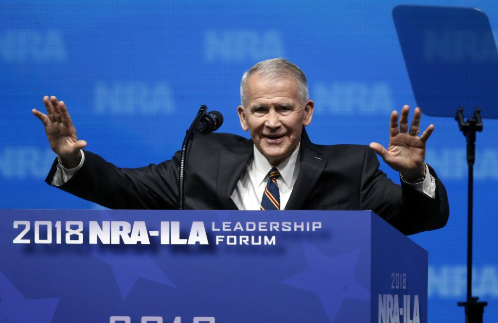 In this May 4, 2018 photo, former U.S. Marine Lt. Col. Oliver North acknowledges attendees as he gives the Invocation at the National Rifle Associatio...