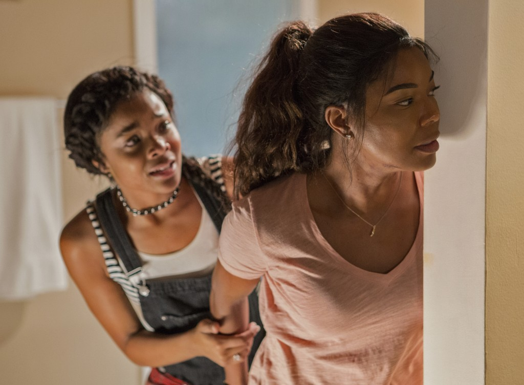 """This image released by Universal Pictures shows Ajiona Alexus, left and Gabrielle Union in """"Breaking In."""" (Paul Sarkis/Universal Pictures via AP)"""