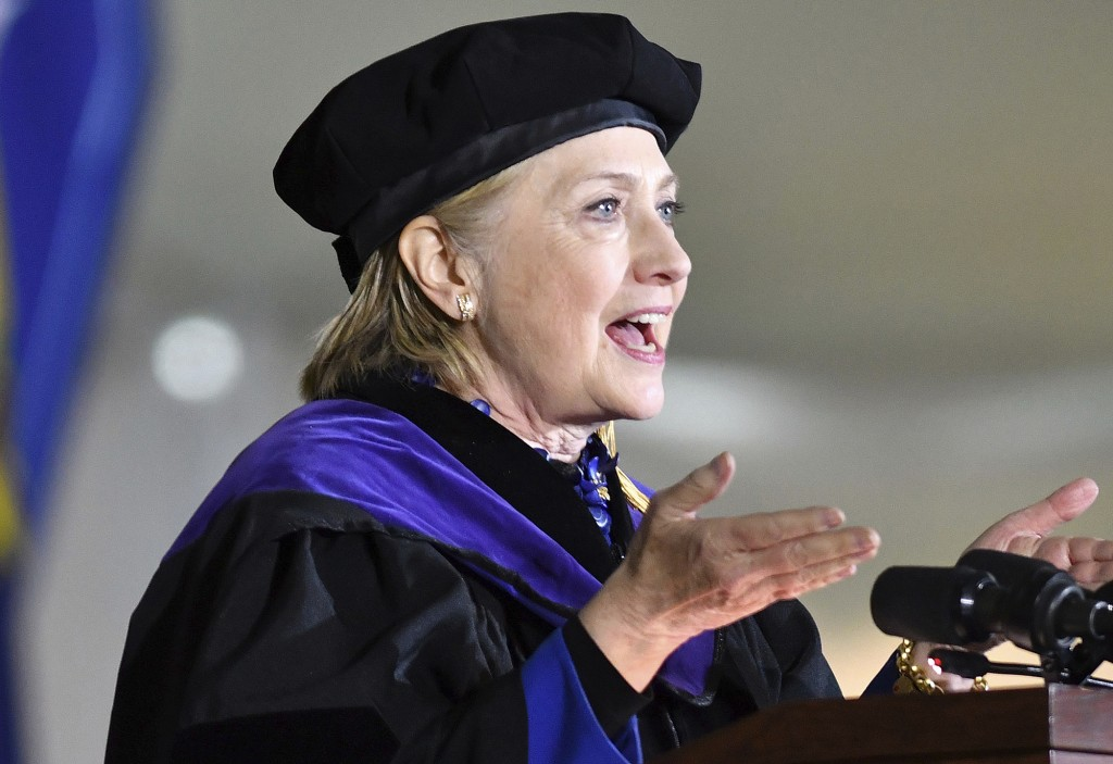 FILE - In this May 26, 2017, file photo, former Secretary of State Hillary Clinton delivers the commencement address at Wellesley College in Wellesley...