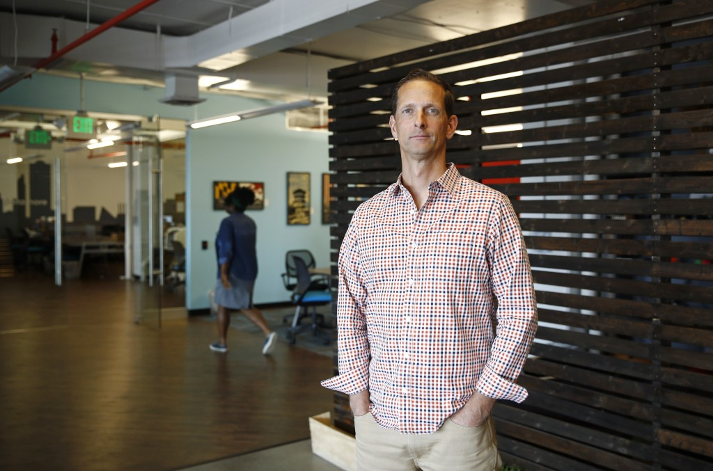 In this May 8, 2018 photo, Justin Shelby, CEO of Artichoke, a company that sells an app to help business owners manage their companies, poses for a ph...