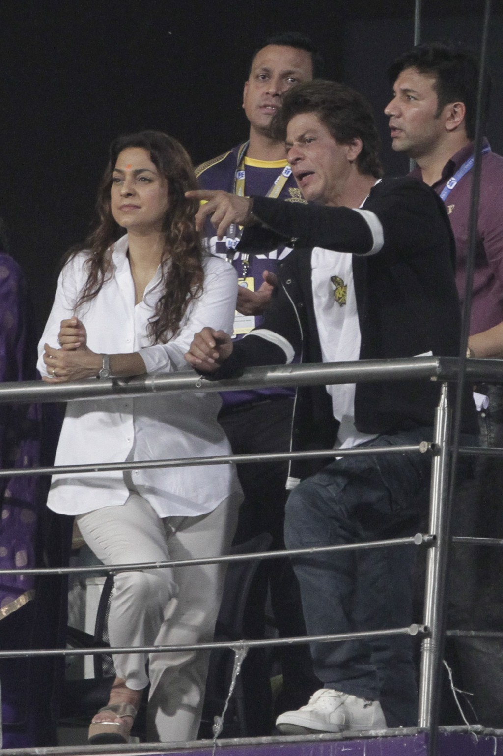 Co-owner of Kolkata Knight Riders and Bollywood actors Shah Rukh Khan, right, and Juhi Chawla chat as they watch their team's match against Mumbai Ind