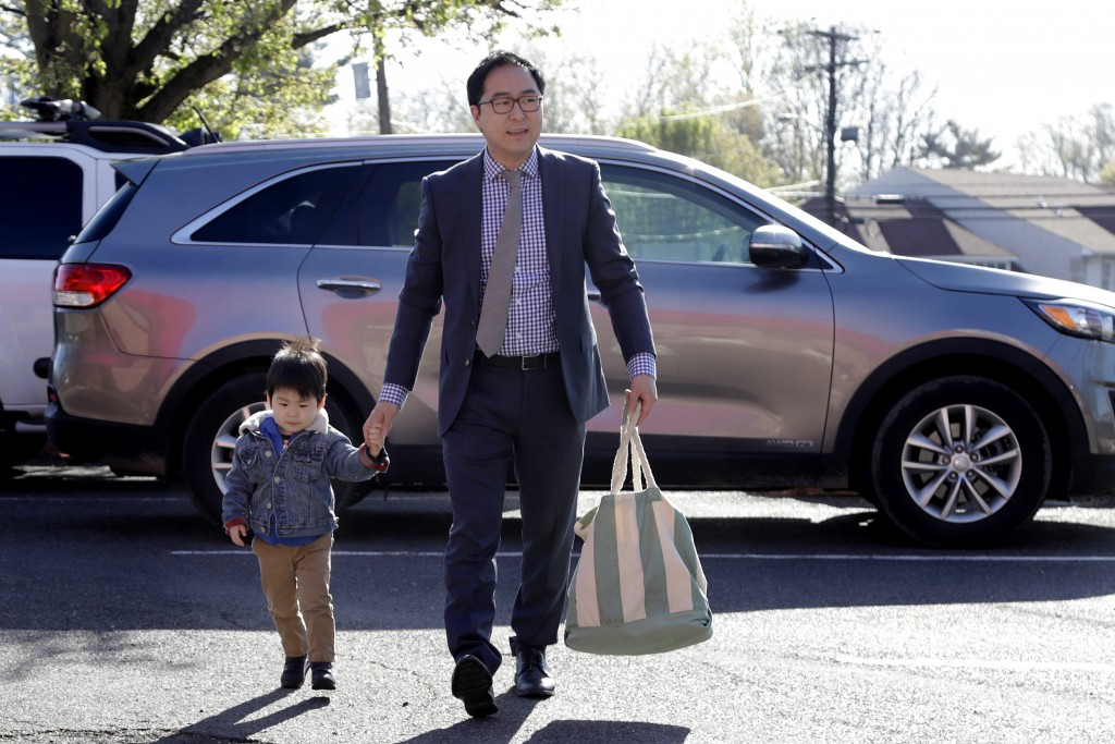 In this Tuesday, May 1, 2018, photo, Andy Kim walks his 2-year-old son, Austin Kim, to school in Bordentown, N.J. Kim, a Democrat who grew up in Marlt...