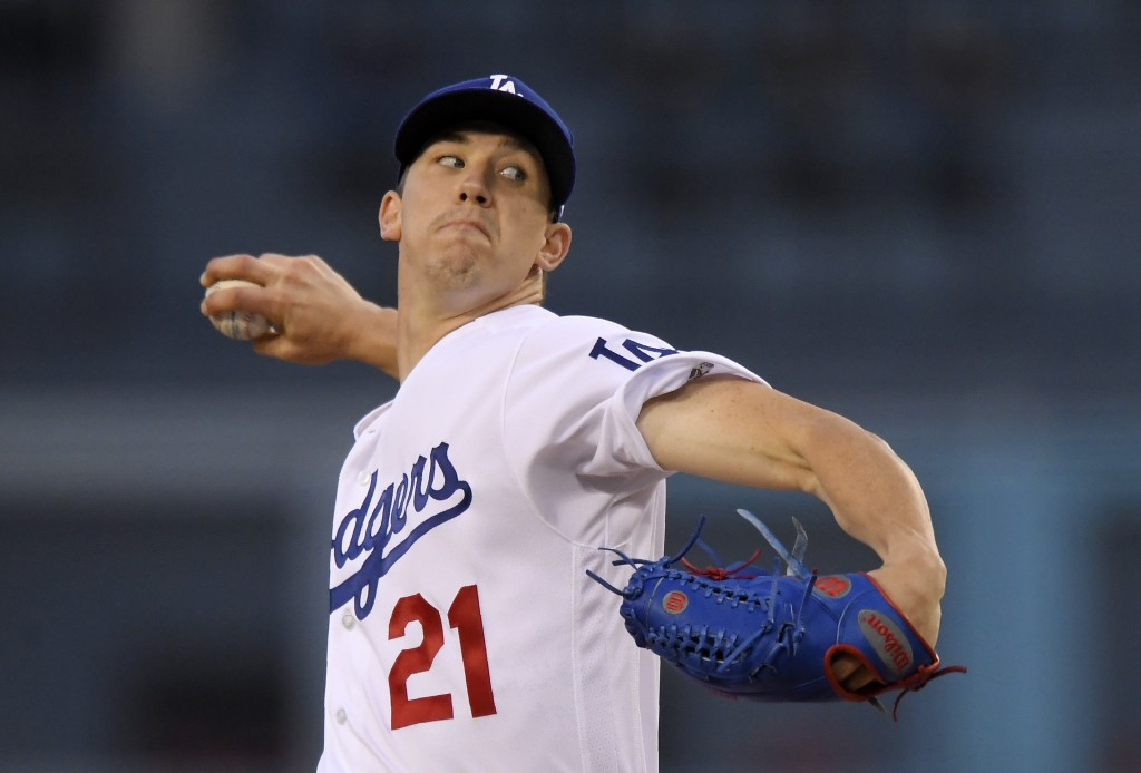 Los Angeles Dodgers starting pitcher Walker Buehler throws to a Cincinnati Reds batter during the first inning of a baseball game Thursday, May 10, 20...