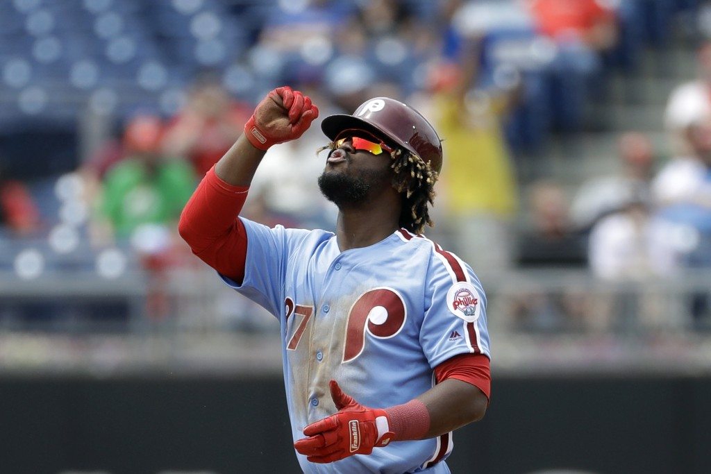 Philadelphia Phillies' Odubel Herrera reacts after hitting a double off San Francisco Giants starting pitcher Ty Blach during the fourth inning of a b...