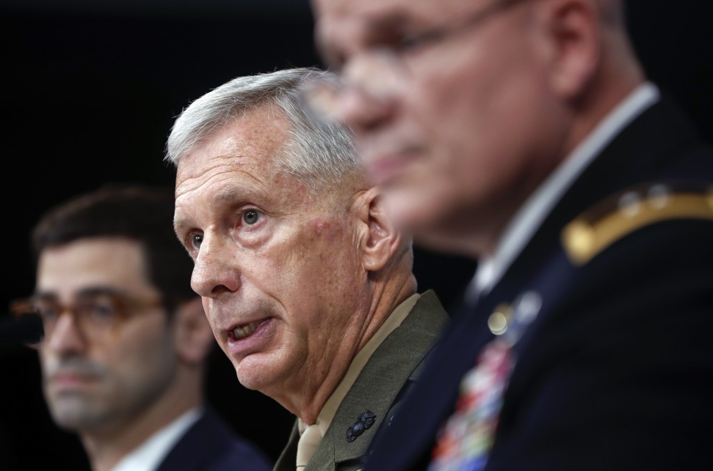 Marine Gen. Thomas D. Waldhauser, commander, center, U.S. Africa Command, with Assistant Secretary of Defense for International Security Affairs Rober