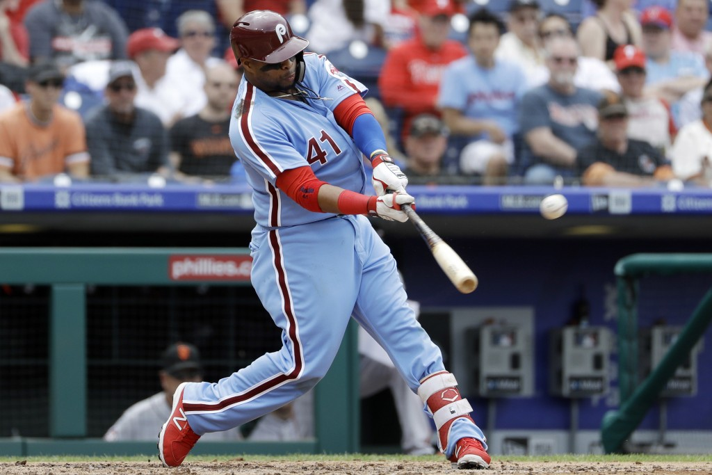 Philadelphia Phillies' Carlos Santana hits a three-run home run off San Francisco Giants starting pitcher Ty Blach during the fourth inning of a baseb...