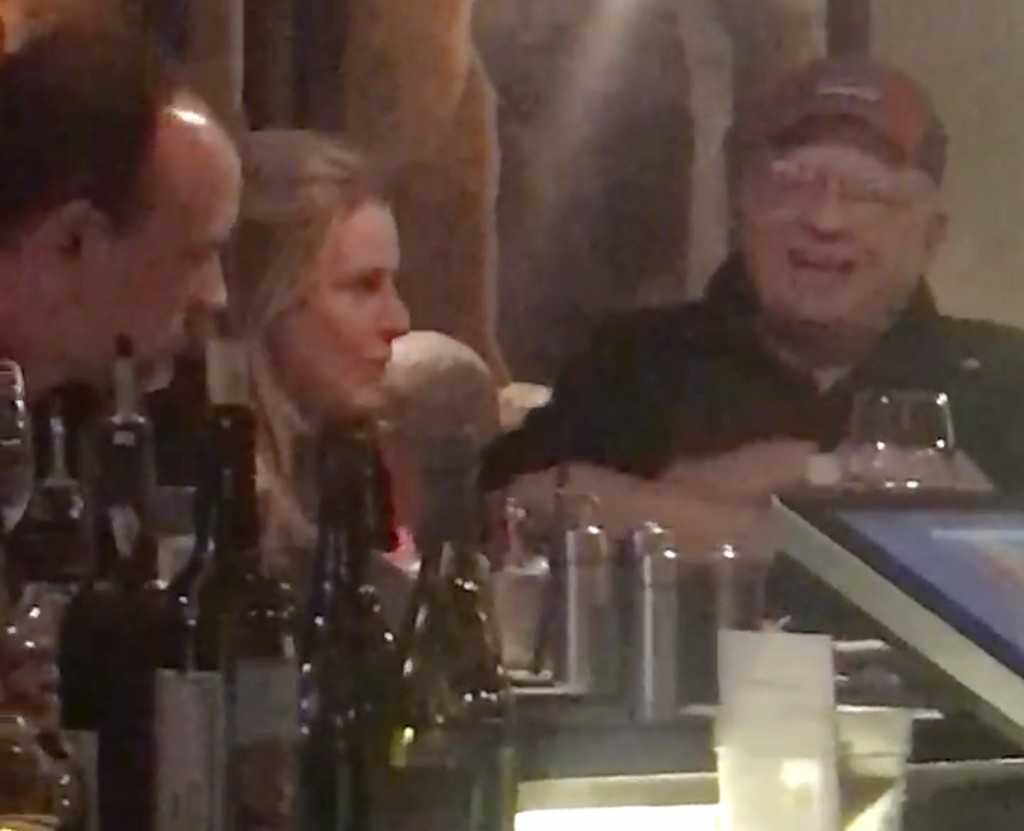 In this image made from a January video provided by Pat McClanahan, Robert Bates, right, is seen sitting at the bar of a Tulsa restaurant. The ex-volu...