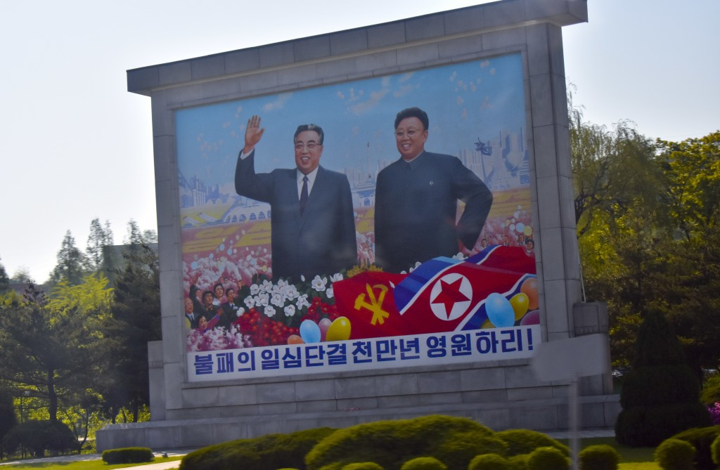 Portraits of late leaders Kim Il Sung, left, and Kim Jong Il, left, are seen along the motorcade route transporting Secretary of State Mike Pompeo and...