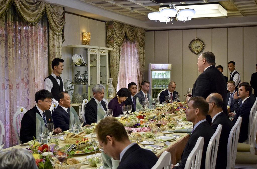 Secretary of State Mike Pompeo, right, stands as he speaks during a dinner between North Korean dignitaries and US diplomats, Pyonyang, North Korea on...